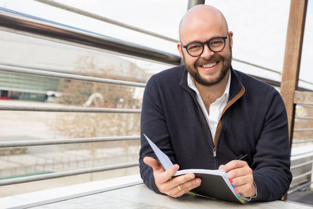 Man writing in his dating diary